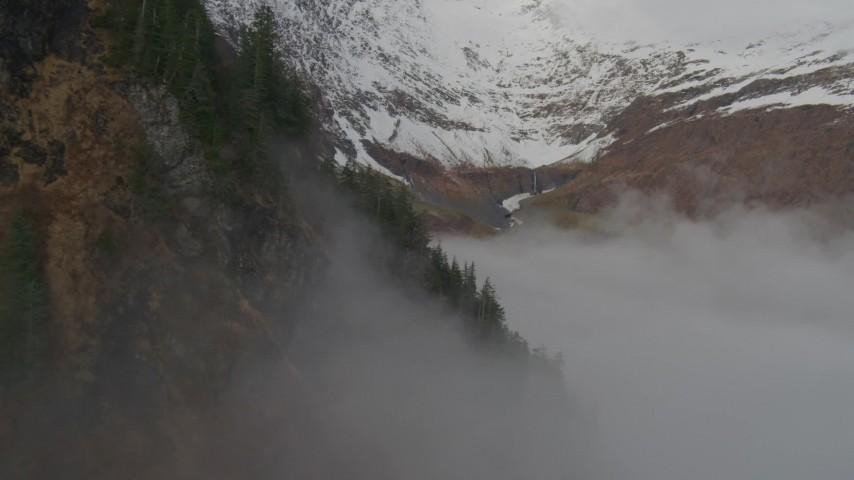 4K stock footage aerial video fly above fog, approach Chugach Mountain peak, Prince William Sound, Alaska Aerial Stock Footage | AK0001_0416