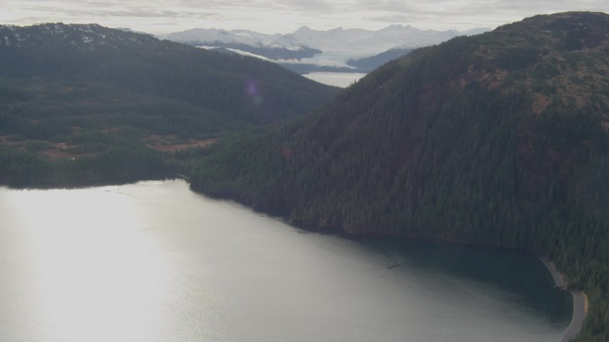 4K stock footage aerial video fly over river valley, approaching forested ridge, Prince William Sound, Alaska Aerial Stock Footage | AK0001_0425