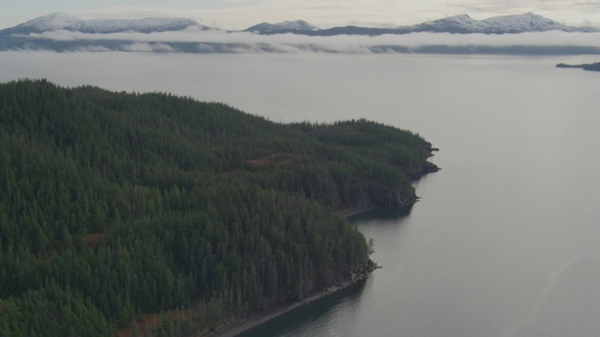 4K stock footage aerial video fly over forested shore of the sound, approaching bay, Prince William Sound, Alaska Aerial Stock Footage | AK0001_0428