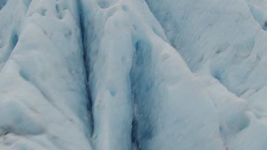 4K stock footage aerial video flying low over surface of a glacier, Prince William Sound, Alaska Aerial Stock Footage | AK0001_0442