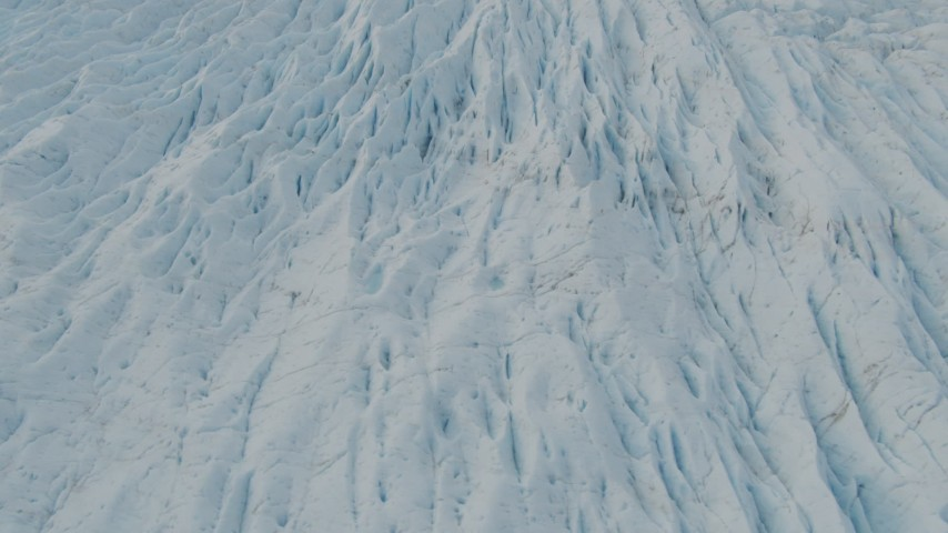 4K stock footage aerial video flying low over surface of a glacier, Prince William Sound, Alaska Aerial Stock Footage | AK0001_0445