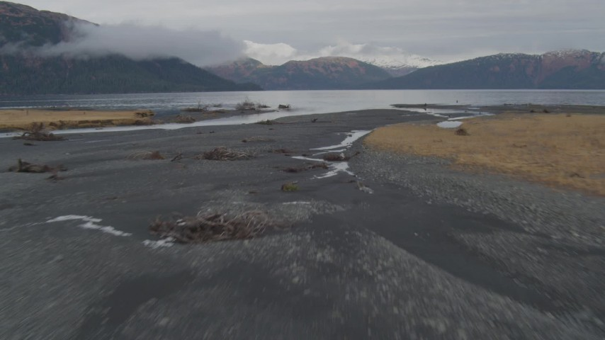 4K stock footage aerial video fly low over river, shoreline, approach open water, Prince William Sound, Alaska Aerial Stock Footage | AK0001_0456