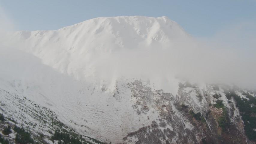 4K stock footage aerial video ascending slope approaching snowy summit, Kenai Mountains, Alaska Aerial Stock Footage | AK0001_0526