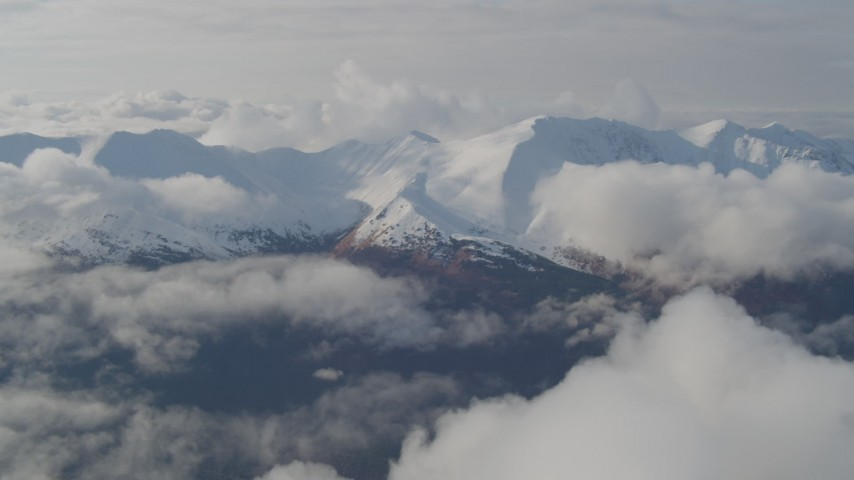 4K stock footage aerial video flying by low clouds over valley bordered by the Kenai Mountains, Alaska Aerial Stock Footage | AK0001_0547