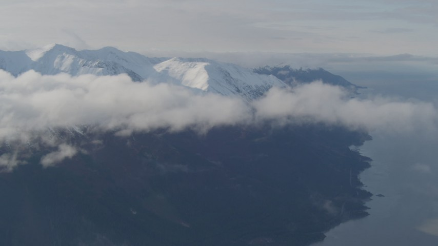 4K stock footage aerial video fly by low clouds, Turnagain Arm of the Cook Inlet, and Kenai Mountains, Alaska Aerial Stock Footage | AK0001_0549