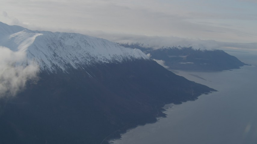 4K stock footage aerial video fly over Turnagain Arm of the Cook Inlet, snow capped Kenai Mountains, Alaska Aerial Stock Footage | AK0001_0551