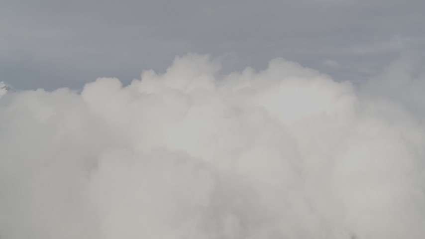 4K stock footage aerial video approaching low, thick clouds, Chugach Mountains, Alaska Aerial Stock Footage   AK0001_0555