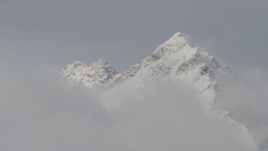 4K stock footage aerial video approaching snow covered peaks, low clouds, Chugach Mountains, Alaska Aerial Stock Footage | AK0001_0560