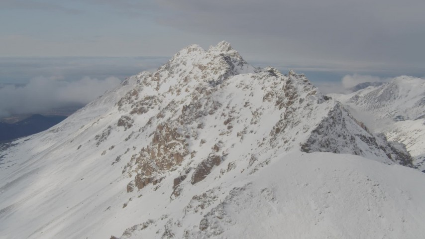 4K stock footage aerial video flying along a snowy covered ridge, Chugach Mountains, Alaska Aerial Stock Footage   AK0001_0564