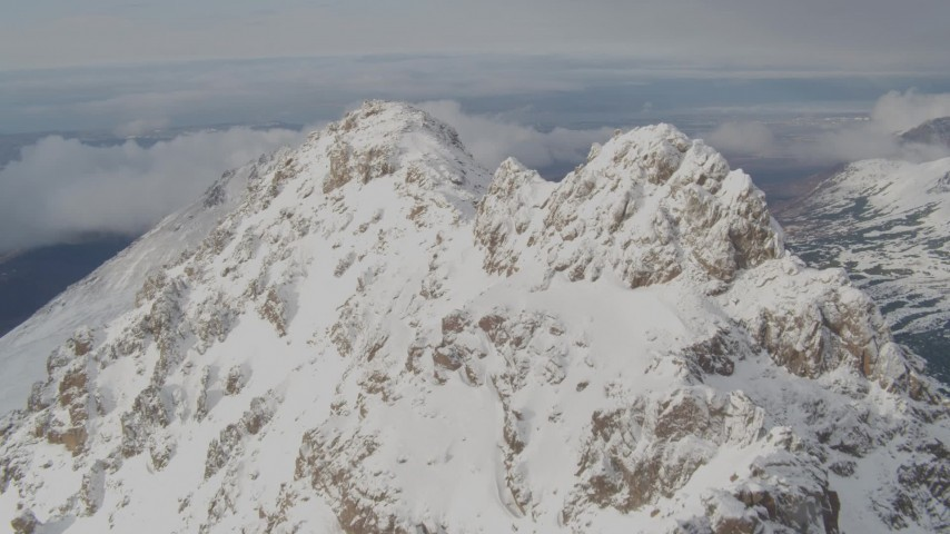 4K stock footage aerial video flying along a snowy ridge, over the summit, Chugach Mountains, Alaska Aerial Stock Footage | AK0001_0565