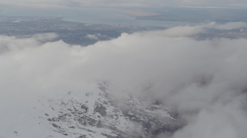 4K stock footage aerial video approach snowy peak, Downtown Anchorage, Chugach Mountains, Alaska Aerial Stock Footage | AK0001_0572