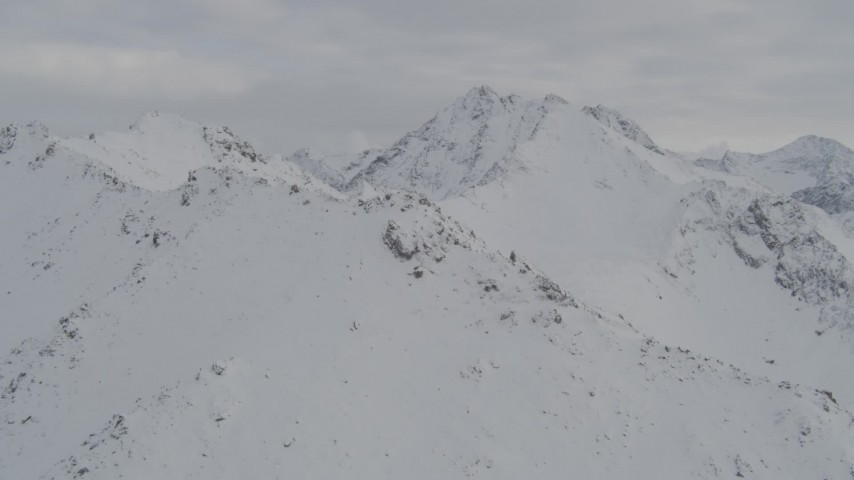 4K stock footage aerial video flying over snowy ridges in the Chugach Mountains, Alaska Aerial Stock Footage | AK0001_0573