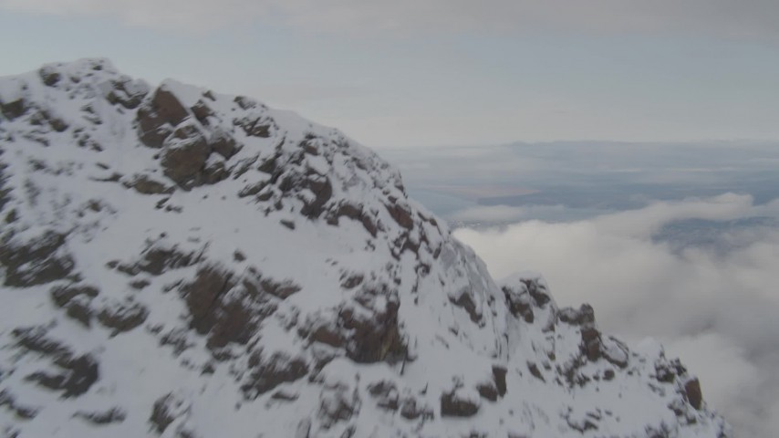 4K stock footage aerial video ascend rocky slopes, reveal low clouds, Anchorage, Chugach Mountains, Alaska Aerial Stock Footage | AK0001_0575