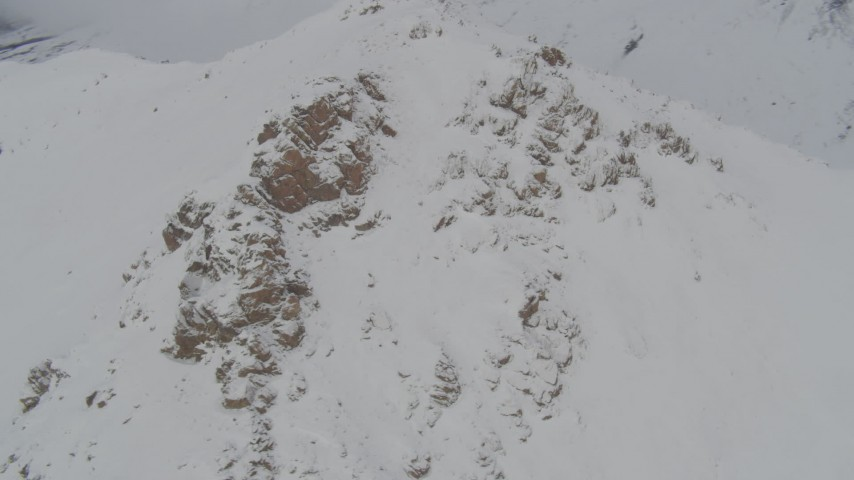 4K stock footage aerial video orbiting a snowy summit, Chugach Mountains, Alaska Aerial Stock Footage | AK0001_0576