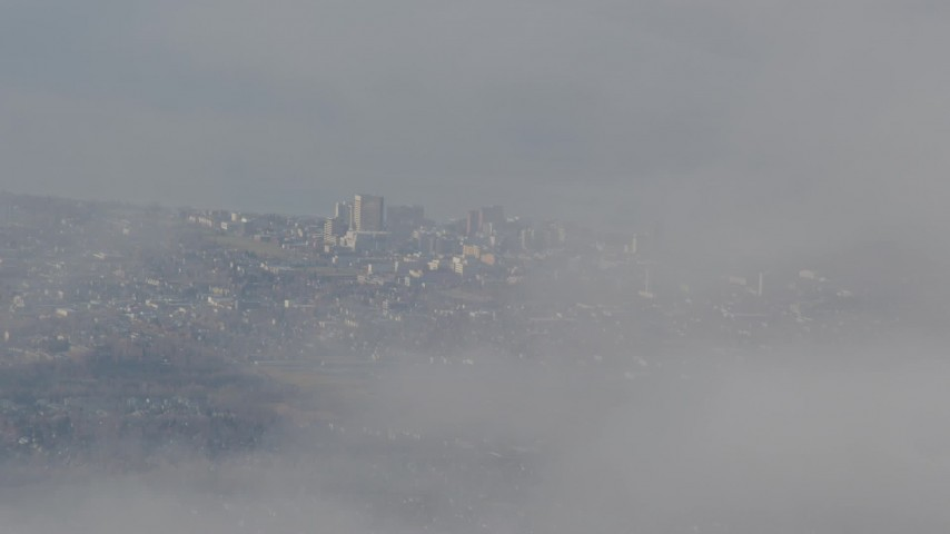 4K stock footage aerial video tilt up from thick clouds, revealing Downtown Anchorage, Alaska Aerial Stock Footage | AK0001_0578