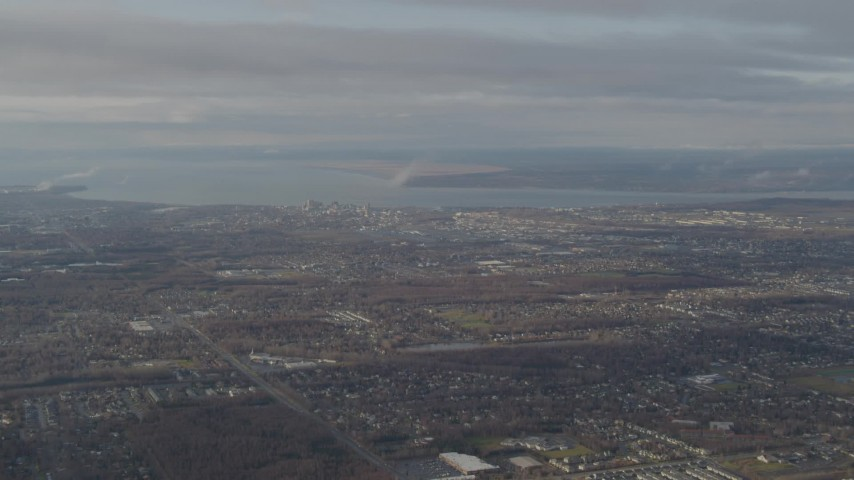4K stock footage aerial video descending through low clouds, revealing Downtown Anchorage, Alaska Aerial Stock Footage | AK0001_0579