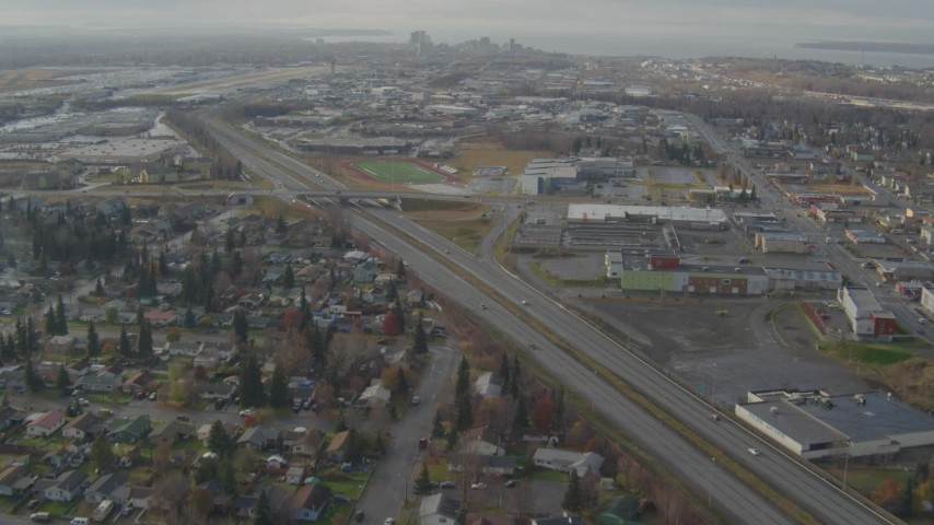 4K stock footage aerial video following Glenn Highway, approach Merrill Field and Downtown Anchorage, Alaska Aerial Stock Footage | AK0001_0581