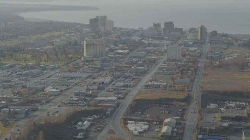 4K stock footage aerial video flying by East 5th Avenue, tilt up, revealing Downtown Anchorage, Alaska Aerial Stock Footage | AK0001_0583
