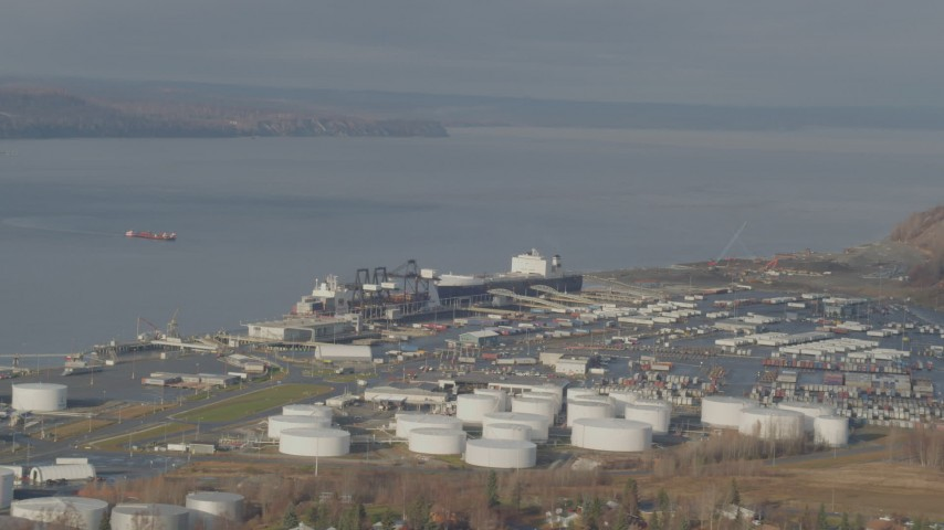 4K stock footage aerial video large tanks and a cargo ship at the port, Anchorage, Alaska Aerial Stock Footage | AK0001_0584