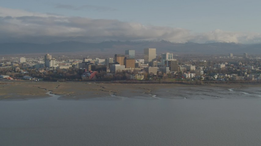 4K stock footage aerial video tilt up from Knik Arm of the Cook Inlet, reveal Downtown Anchorage, Alaska Aerial Stock Footage | AK0001_0598