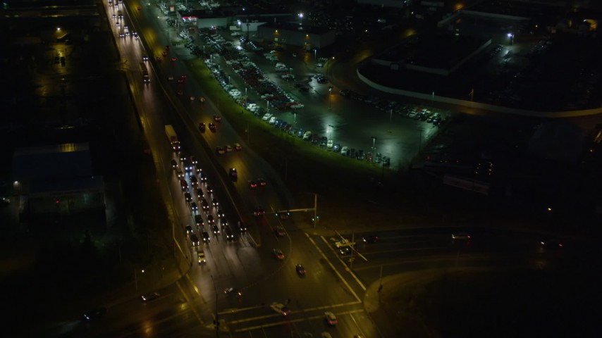 4K stock footage aerial video flying by East 5th Avenue, near car dealership, Anchorage, Alaska, night Aerial Stock Footage | AK0001_0599