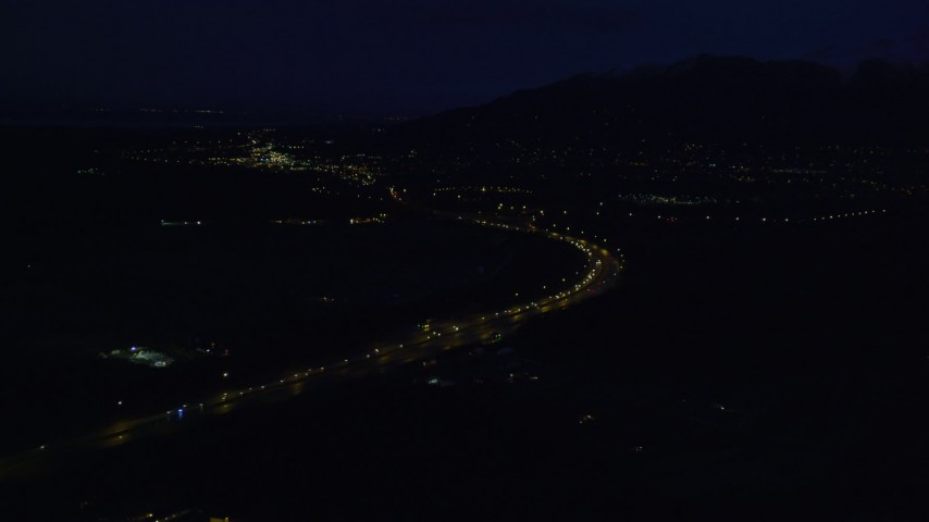 4K stock footage aerial video flying over Glenn Highway, approach Chugach Mountains, Anchorage, Alaska, night Aerial Stock Footage   AK0001_0603