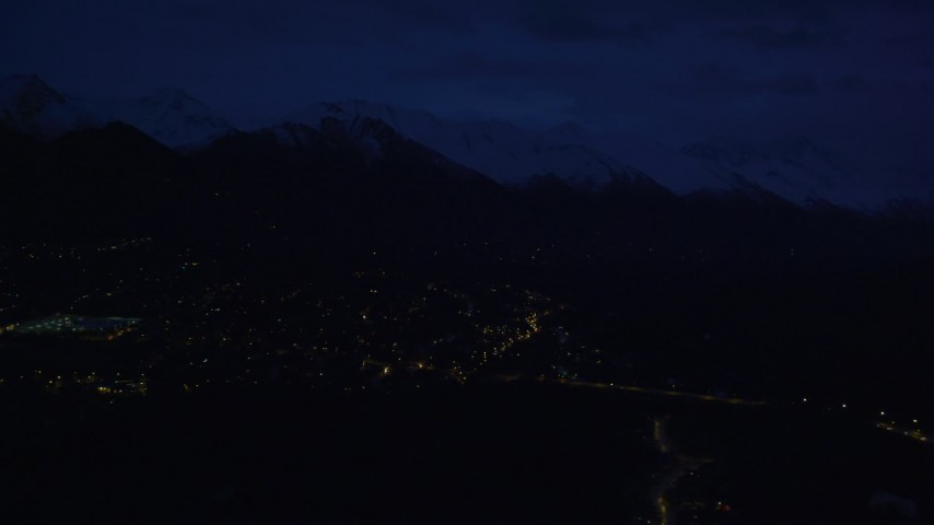 4K stock footage aerial video fly by neighborhood lights, base of Chugach Mountains, Anchorage, Alaska, night Aerial Stock Footage | AK0001_0605
