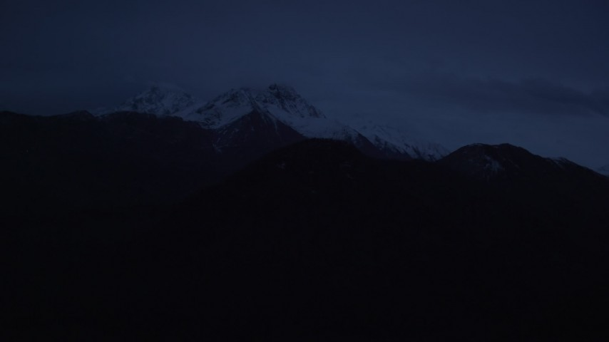 4K stock footage aerial video approaching snow-capped Chugach Mountains, Alaska, sunrise Aerial Stock Footage | AK0001_0609