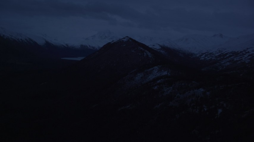 4K stock footage aerial video flying by snow-capped Chugach Mountains, Alaska, sunrise Aerial Stock Footage | AK0001_0611