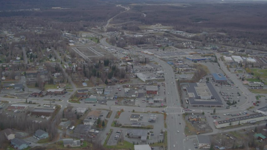 4K aerial video Old Glenn Highway through town, tilt up to reveal shops, Eagle River, Alaska Aerial Stock Footage | AK0001_0663