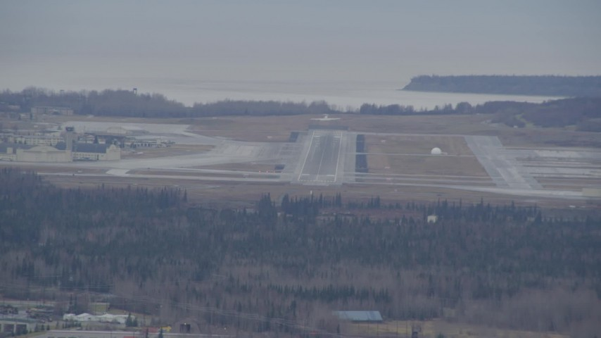 4K stock footage aerial video tracking a military jet taking off, Elmendorf Air Force Base, Anchorage, Alaska Aerial Stock Footage | AK0001_0667