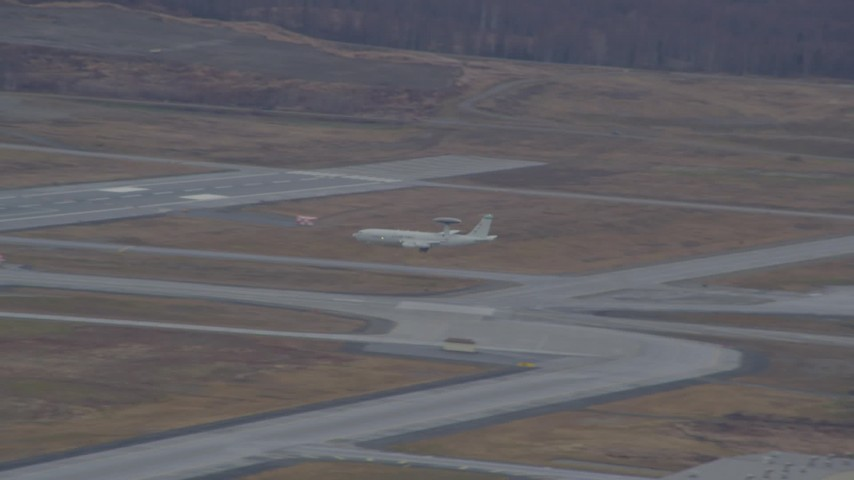 Tracking E-3 Sentry landing, Elmendorf Air Force Base, Alaska Aerial Stock Footage | AK0001_0672