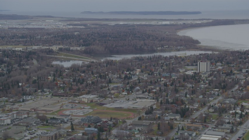 4K stock footage aerial video flying over residential buildings to Westchester Lagoon, Anchorage, Alaska Aerial Stock Footage | AK0001_0675