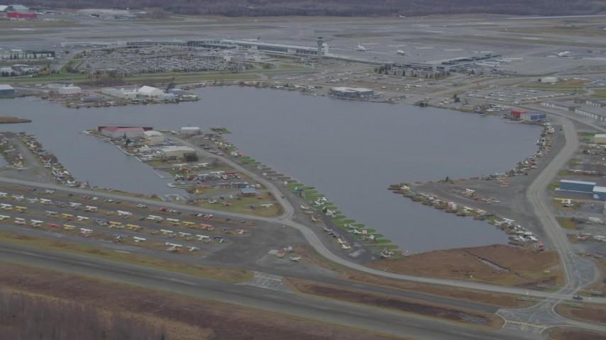 4K stock footage aerial video Lake Hood Seaplane Base, Ted Stevens Anchorage International Airport, Anchorage, Alaska Aerial Stock Footage AK0001_0678 | Axiom Images