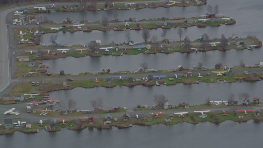 4K stock footage aerial video seaplanes parked in Lake Hood Seaplane Base, Anchorage, Alaska Aerial Stock Footage | AK0001_0684