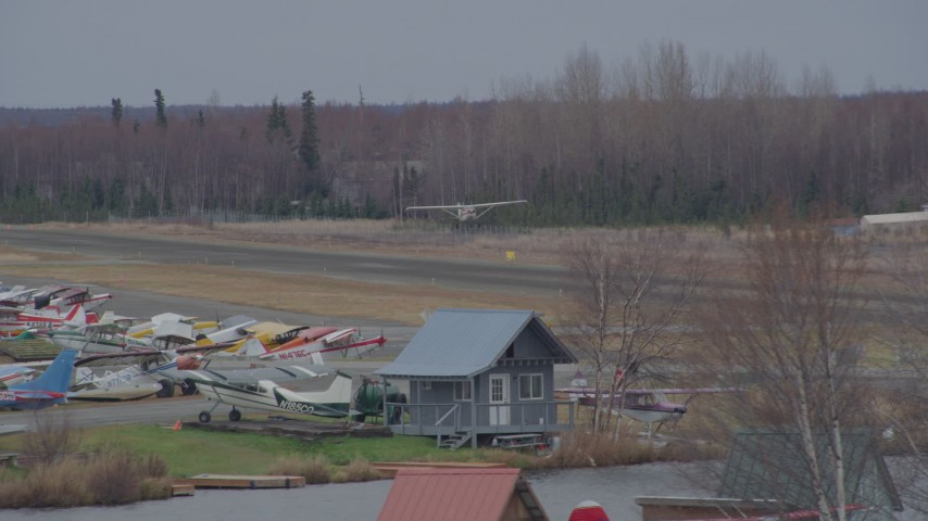4K stock footage aerial video tracking small plane taking off, Lake Hood Seaplane Base, Anchorage, Alaska Aerial Stock Footage | AK0001_0686
