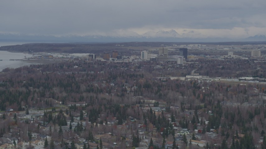 4K stock footage aerial video flying near Westchester Lagoon, approaching Downtown Anchorage, Alaska Aerial Stock Footage | AK0001_0688