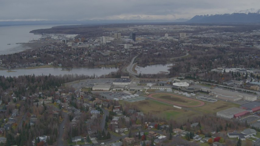 4K stock footage aerial video flying over Anchorage West High School, approach Downtown Anchorage, Alaska Aerial Stock Footage | AK0001_0689