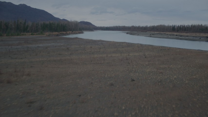 4K stock footage aerial video flying low over grassland, approaching river, winter, Knik River, Alaska Aerial Stock Footage | AK0001_0700