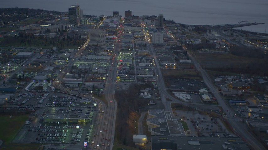 4K aerial video following East 5th Avenue, revealing Downtown Anchorage, Alaska, twilight  Aerial Stock Footage | AK0001_0726