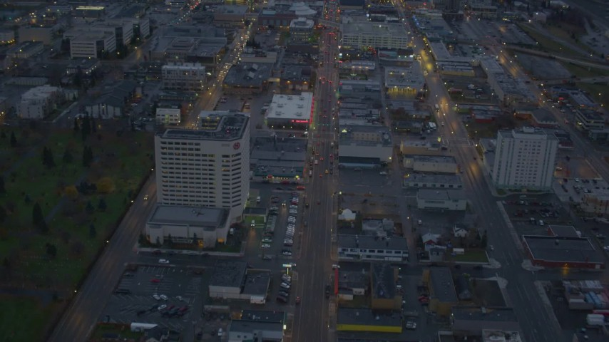 4K aerial video following East 6th Street, revealing Downtown Anchorage, Alaska, twilight Aerial Stock Footage | AK0001_0727