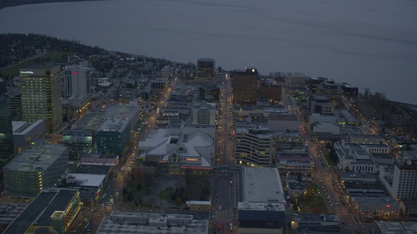 4K stock footage aerial video West 5th Ave to Knik Arm of the Cook Inlet, Downtown Anchorage, Alaska, twilight Aerial Stock Footage | AK0001_0728