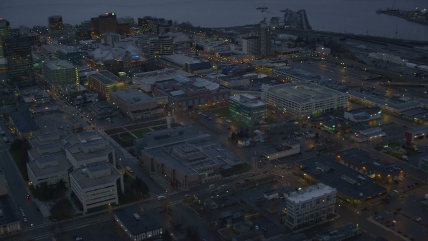4K stock footage aerial video West 8th St and office buildings in Downtown Anchorage, Alaska, twilight Aerial Stock Footage | AK0001_0730
