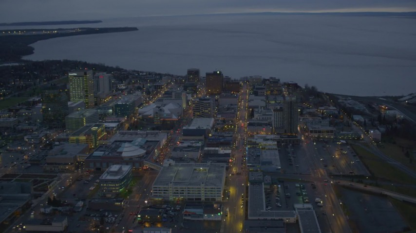 4K stock footage aerial video West 6th Ave to West 3rd Ave, winter, Downtown Anchorage, Alaska, twilight Aerial Stock Footage | AK0001_0731