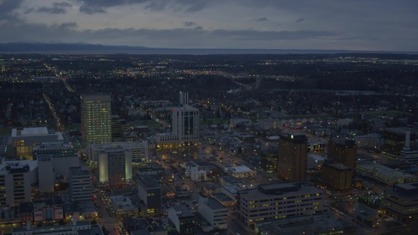 4K stock footage aerial video flying by buildings near shoreline, winter, Downtown Anchorage, Alaska, twilight Aerial Stock Footage | AK0001_0732