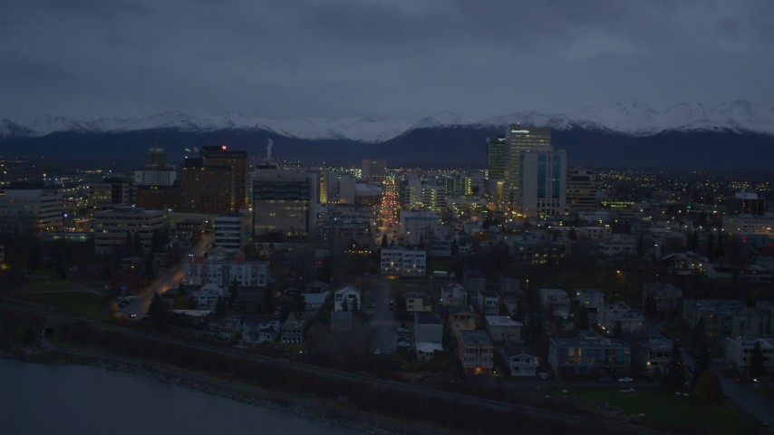 4K stock footage aerial video over Knik Arm of the Cook Inlet, winter, toward Downtown Anchorage, Alaska, night Aerial Stock Footage | AK0001_0735