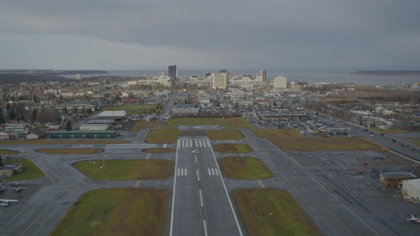 4K stock footage aerial video ascend from Merrill Field, fly by Downtown Anchorage, Alaska Aerial Stock Footage | AK0001_0739