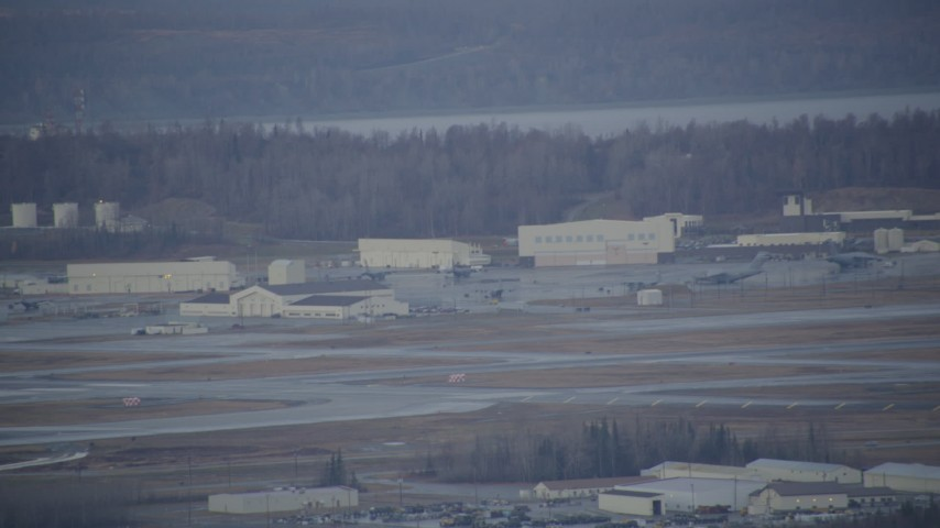 4K stock footage aerial video a view of hangars, aircraft in winter, Elmendorf Air Force Base, Anchorage Aerial Stock Footage | AK0001_0741
