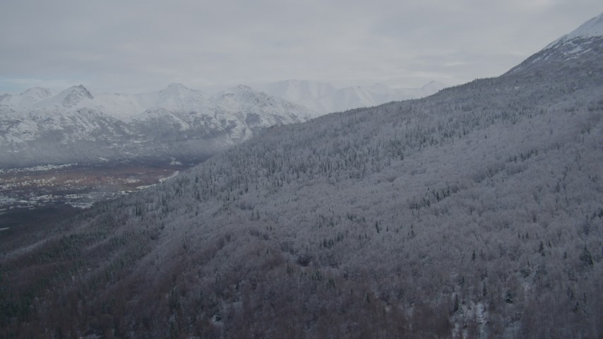 4K aerial video approach snow-covered Chugach Mountains, Eagle River Valley, Eagle River, Alaska Aerial Stock Footage | AK0001_0744