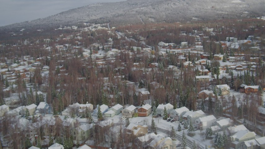 4K stock footage aerial video snowy residential neighborhood, Eagle River Valley, Eagle River, Alaska Aerial Stock Footage | AK0001_0750